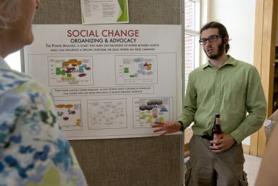 "Charles Kenyon '15 of Buffalo, N.Y., discusses what he learned in the practitioner-taught course ""Social Change,"" taught by Craig Saddlemire '05. (Phyllis Graber Jensen/Bates College)"