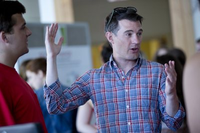 "Mike Lydon '04, principal at The Street Plans Collaborative, led the ""Practicum in Urban Planning,"" which included the creation of a bike lane in downtown Lewiston. (Phyllis Graber Jensen/Bates College)"