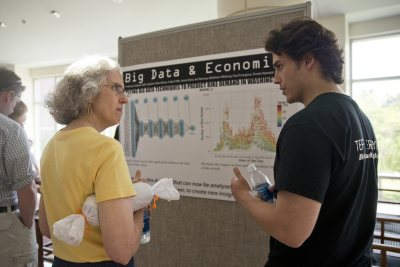 "Sociologist Emily Kane, who played a central role in developing Bates' recent Short Term programming, listens as Tynan Daly '15 of Lake Forest, Ill., describes the ""Big Data and Economics"" course he took. (Phyllis Graber Jensen/Bates College)"