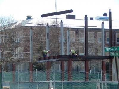 Erectors at work on April 22, 2015, the first day of hanging steel at the 65 Campus Ave. student residence. (Doug Hubley/Bates College)