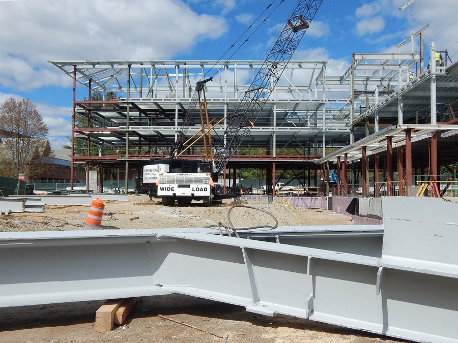 With a piece of structural steel in the foreground awaiting its ride in the sky, the skeleton of the 65 Campus Ave. student residence is shown on May 13, 2015. (Doug Hubley/Bates College)