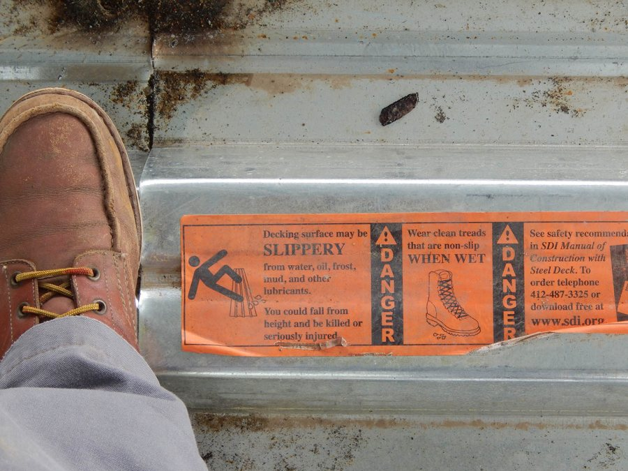 A safety warning on the steel floor decking at 65 Campus Ave. (Doug Hubley/Bates College)