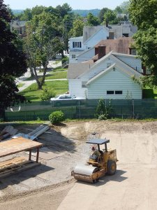 The zoom lens compresses the view and the vibratory roller compresses the soil behind 65 Campus Ave. on July 28, 2015. (Doug Hubley/Bates College)