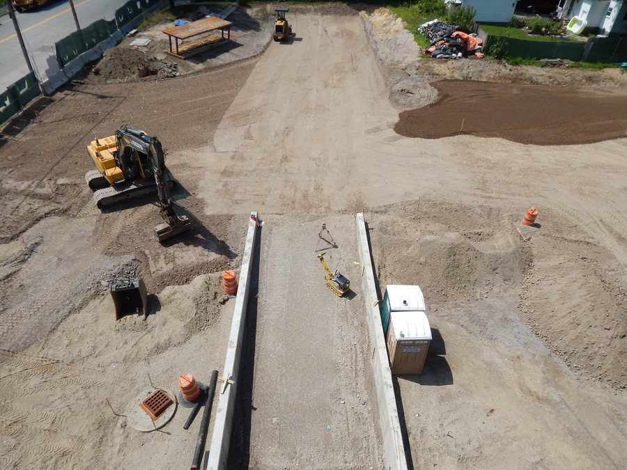 Taken July 28, 2015, this southward view from the fourth floor of 65 Campus Ave. shows the future loading dock for the College Store and Office Services, and the soon-to-be paved parking lot. (Doug Hubley/Bates College)