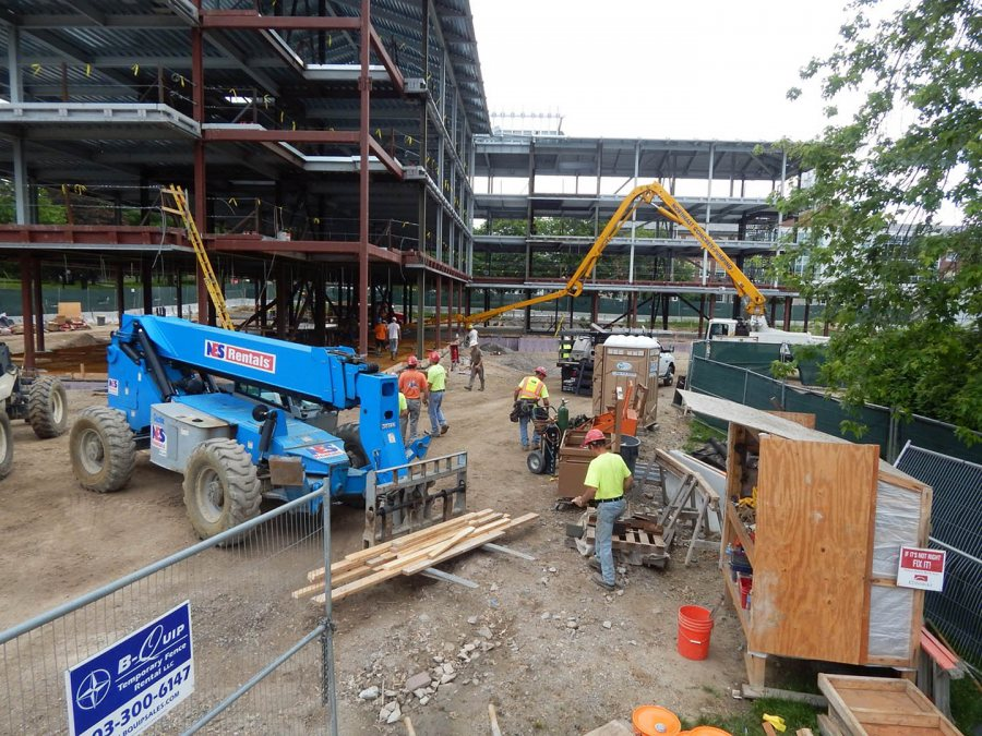 Getting to work at 65 Campus Ave. on June 12, 2015. (Doug Hubley/Bates College)
