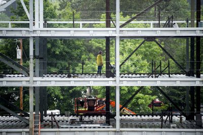 Work continues through the rain at 55 Campus Avenue on July 1, 2015. (Josh Kuckens/Bates College)