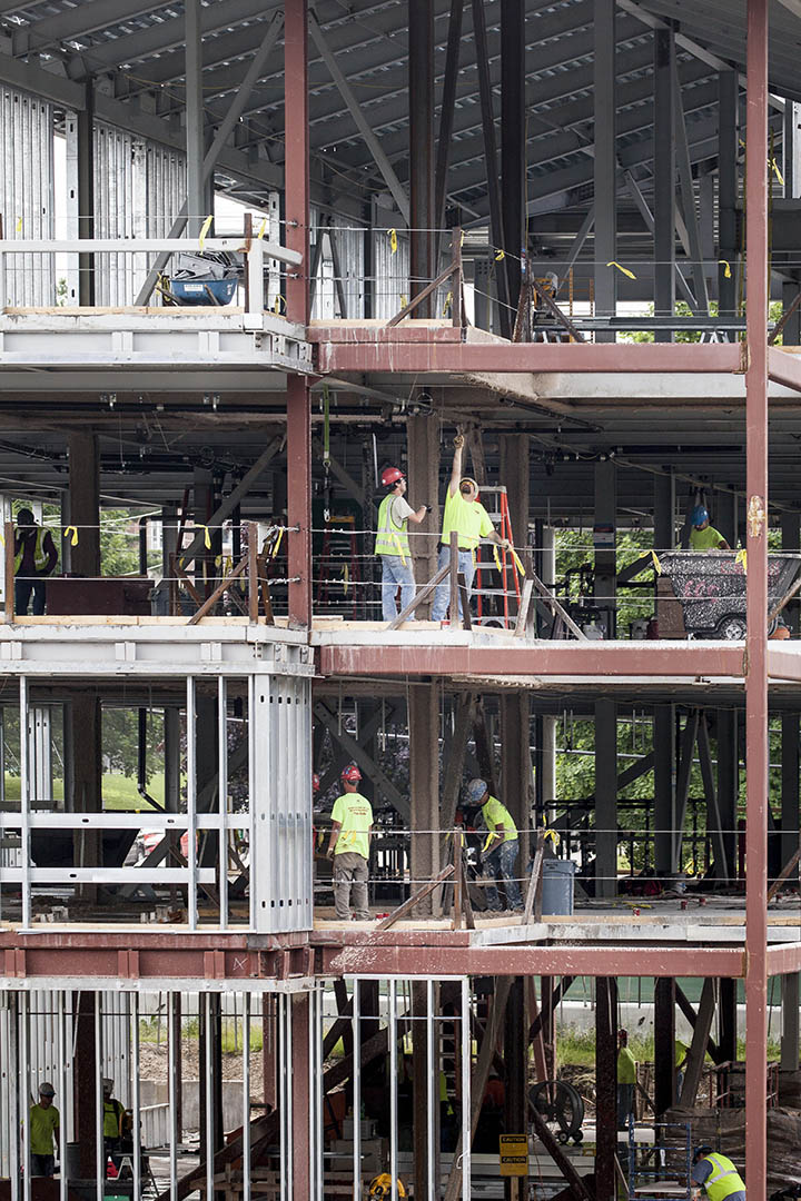 Workers at 65 Campus Ave. on July 2, 2015. (Josh Kuckens/Bates College)