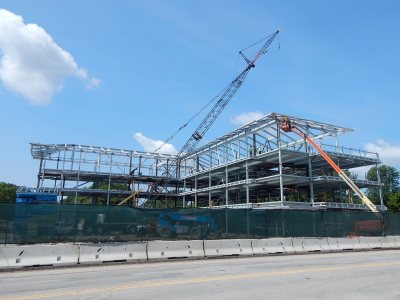 Erectors working for Stellar Steel mount roof supports on the 55 Campus Ave. student residence on July 6, 2015. (Doug Hubley/Bates College)