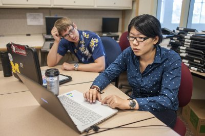 Fan Dong, '17, at right, is serving as a research assistant to economics professor Nathan Tefft this summer, helping to assess potential health benefits of fracking. With her is a second Tefft research assistant, Mike Varner '17, who is studying economic determinants of household expenditures on dietary supplements. (Josh Kuckens/Bates College)