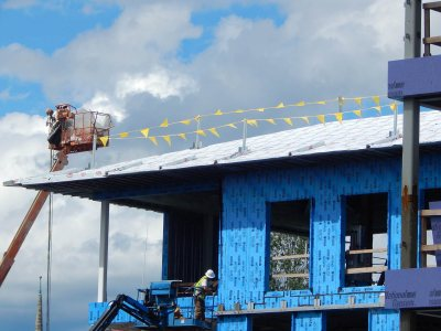 Weatherproof film on the roof of 65 Campus Ave. on Aug. 13, 2015. (Doug Hubley/Bates College)