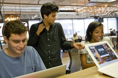 Purposeful Work intern Joaquin Espinosa '16 of Quito, Ecuador, checks in with other interns at 1776, a global incubator and seed fund. Based in Washington, D.C., the firm helps startups in education, energy/sustainability, health, and transportation and smart cities. (Phyllis Graber Jensen/Bates College)