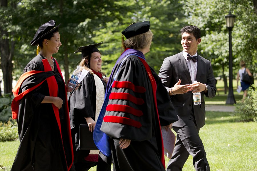 Bates' 2015 Convocation speakers -- keynote Danielle Allen, multifaith chaplain Brittany Longsdorf, Bates President Clayton Spencer, and Student Government President Berto Diaz '16 -- cross the Historic Quad during the event. (Phyllis Graber Jensen/Bates College)