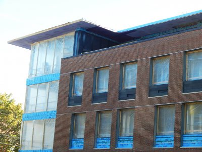 Complete with natty charcoal-gray Taktl inserts, a third-story row of dorm-room window units had been installed at 65 Campus Ave. by Oct. 16, 2015. (Doug Hubley/Bates College)