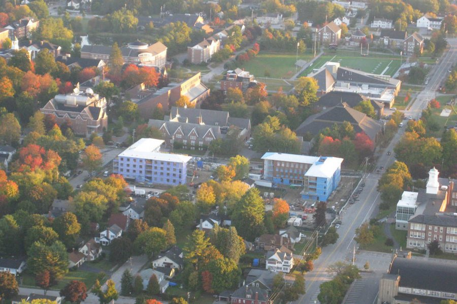 Taken by Judith Marden '66 from an ultralight aircraft piloted by Mike Theriault on Oct. 12, 2015, this campus view shows the L-shaped Campus Life Project dorms at center. (Judith Marden '66 for Bates College)