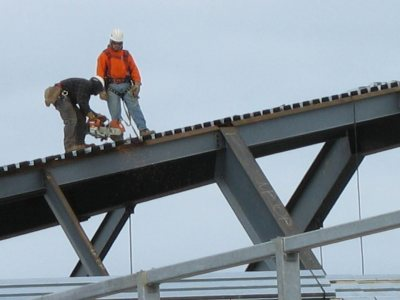 Workers building the new Commons roof on April 9, 2007. (Doug Hubley/Bates College)