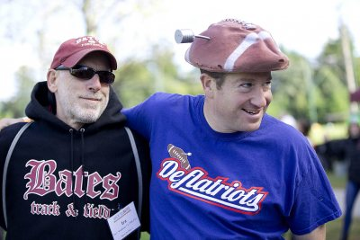 Michael Lieber '92 shows off his Deflatiots gear at Back to Bates on Oct. 3 as he hangs out with Ira Waldman '73. (Phyllis Graber Jensen/Bates College).