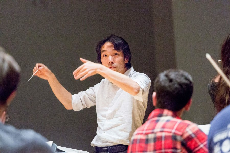 Hiroya Miura conducts the Bates College Orchestra in rehearsal in 2015. (Josh Kuckens/Bates College)