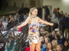 """Krims hits the runway wearing Tejada's design, featuring magazines, aluminum cans, videotape, and cardboard. """"If Barbarella and Madonna had a child, this would be her,"""" said Tejada. (Josh Kuckens/Bates College)"""