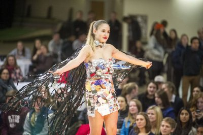 "Krims hits the runway wearing Tejada's design, featuring magazines, aluminum cans, videotape, and cardboard. ""If Barbarella and Madonna had a child, this would be her,"" said Tejada. (Josh Kuckens/Bates College)"