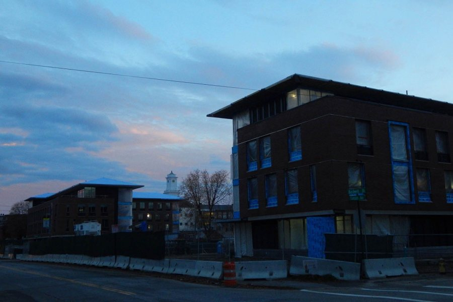 The new student residences at 65 (left) and 55 Campus Ave., seen at dusk Nov. 6, 2015. The cupola in between belongs to Lewiston Middle School. (Doug Hubley/Bates College)