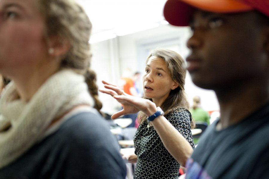 Assistant Professor of Education Mara Tieken circulates among small groups of students as they discuss what makes good teaching. Through fieldwork and classroom work, education students learn about the field's interdisciplinary perspectives and the practical realities today. (Phyllis Graber Jensen/Bates College)