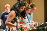 Zofia Ahmad '19 of Palo Alto, Calif., and bandmates perform an encore during a Bates Steel Pan Orchestra concert in December 2015. The orchestra makes its Arts Crawl debut on Jan. 28. (Josh Kuckens/Bates College)