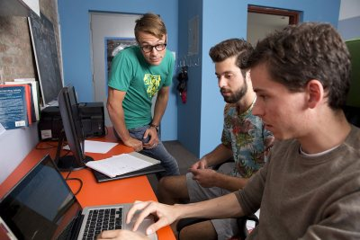 Schippers works with HappyFunCorp staffers, including account executive Matthew Perejda '14. (Phyllis Graber Jensen)