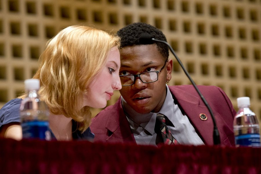 Zoe Seaman-Grant '17 of the Brooks Quimby Debate Council and Jonathan Carlisle, Morehouse College Class of 2017, are shown during the 2015 Rev. Benjamin Elijah Mays debate on Martin Luther King Jr. Day. (Phyllis Graber Jensen/Bates College)