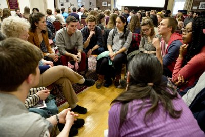 """Members of the Bates and Lewiston-Auburn communities share their views in the Muskie Archives during the 2015 MLK Day workshop """"Perspectives on Ferguson."""" (Phyllis Graber Jensen/Bates College)"""