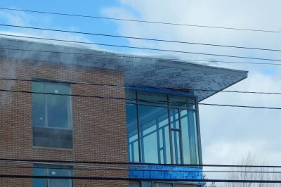 A closer view of storefront glass on the 65 Campus Ave. residence on Jan. 13, 2016 -- a gusty day following a moderate snowfall. (Doug Hubley/Bates College)