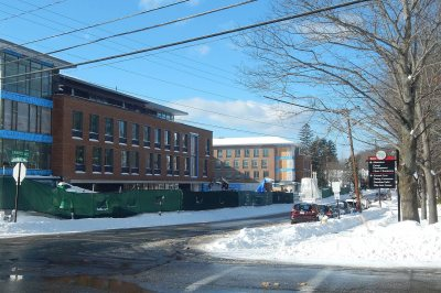 With the 65 Campus Ave. residence at left and the Muskie Archives quad at right, the Central-Campus intersection will serve as the gateway to campus. Notice the storefront glass and the stepped-back fourth floor on the dorm. (Doug Hubley/Bates College)
