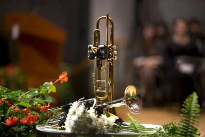 Trumpets belonging to the late James Jhun '16 are displayed during the memorial service and celebration of his life on Jan. 22 in the Olin Arts Center Concert Hall. (Phyllis Graber Jensen/Bates College)