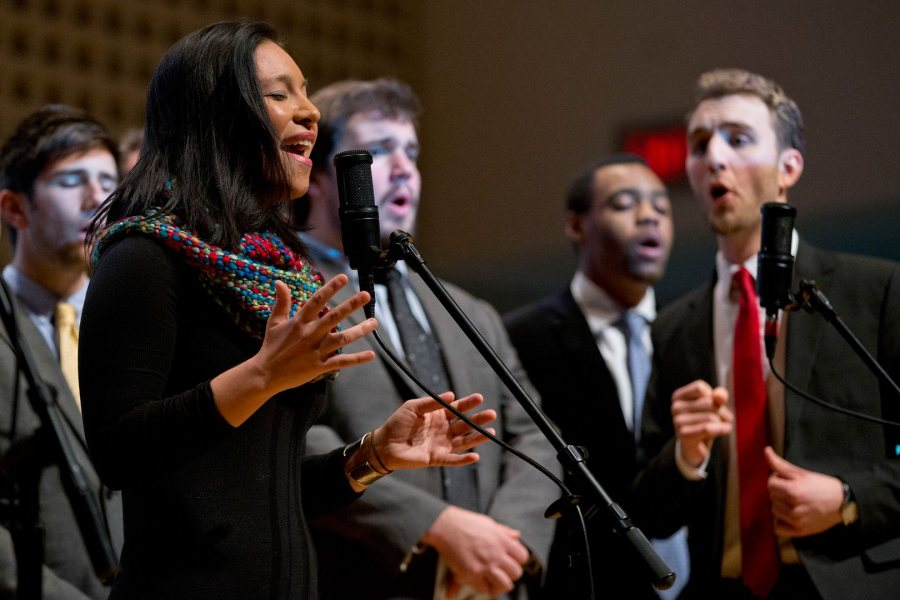 "Supported by the Manic Optimists, Isabel Koyama sings ""Till There Was You"" during a memorial service for James Jhun '16 on Jan. 22, 2016. Jhun, Koyama and Jonah Greenawalt created the arrangement for the Meredith Willson tune. (Phyllis Graber Jensen/Bates College)"