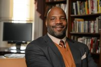 William Jelani Cobb gives the Martin Luther King Jr. Day keynote address at Bates on Jan. 18. (Peter Morenus/University of Connecticut)