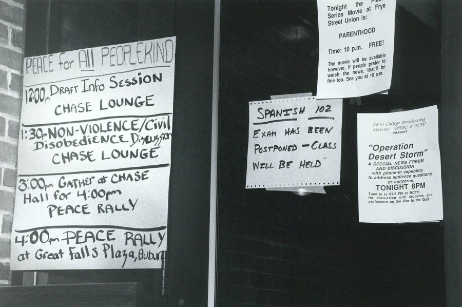 "Flyers and messages during the Persian Gulf War hang, likely outside Ladd library, including one about the movie ""Parenthood"" being shown at Frye Street Union, noting that ""if people prefer to watch the news, that'll be fine too."" (Bates Communications)"