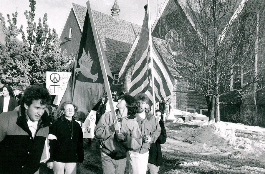 A peace protest passes by Chase Hall in the days following the start of the Persian Gulf War in January 1991. (Bates Communications)