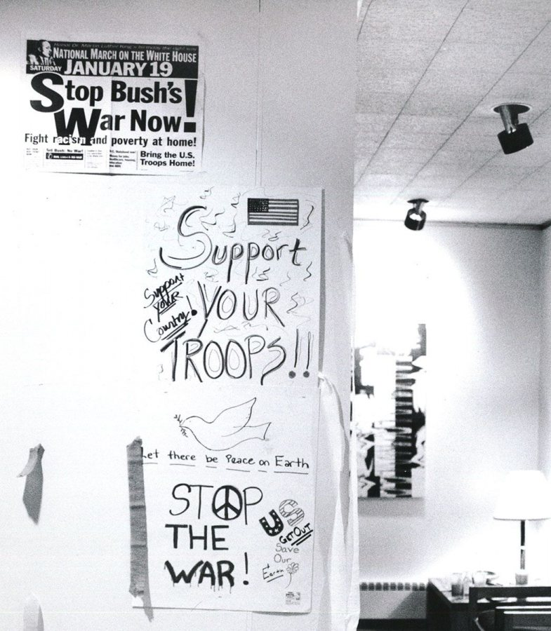 "During the Persian Gulf War, the slogan ""support the troops"" emerged alongside anti-war messages, like these, likely in Chase Hall Gallery. (Bates Communications)"