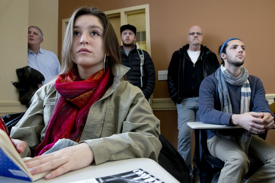 "A student listens to the panel discussion on ""Global Accounts of State Violence and Identity."" (Phyllis Graber Jensen)"