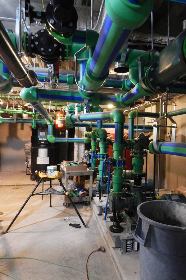 This complex of valves in the basement controls the clean water supply at 65 Campus Ave. (Doug Hubley/Bates College)