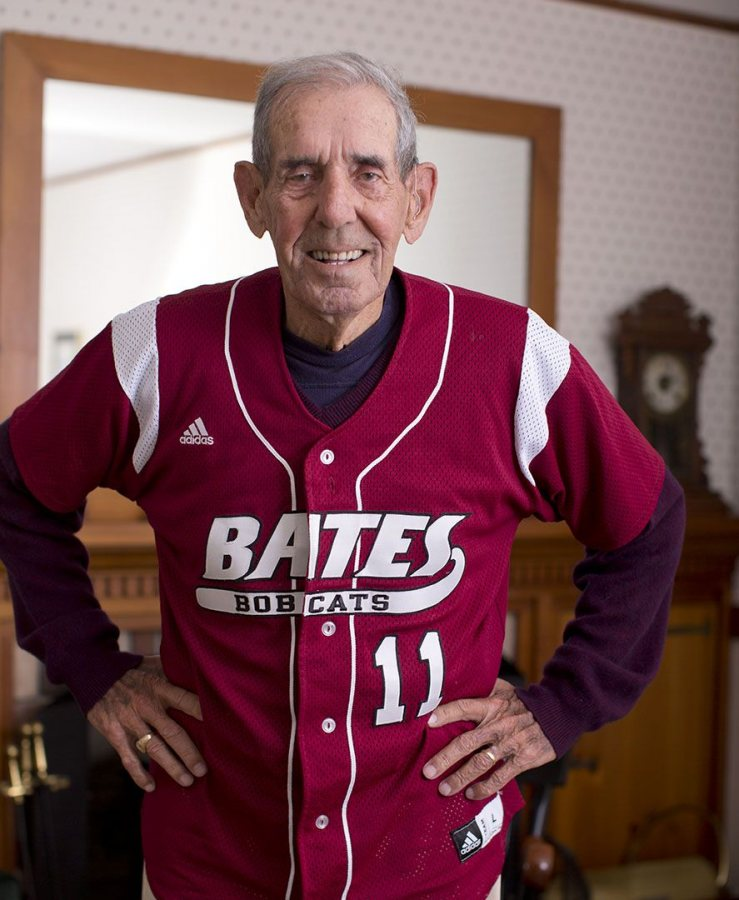 "William ""Chick"" Leahey '52 dons his No. 11 Bates jersey at his home on East Avenue. His jersey will be retired Saturday at halftime of the Homecoming football game vs. Colby. (Phyllis Graber Jensen/Bates College)"