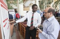 Emmanuel Toroitich '15 of Eldoret, Kenya, explains to a visitor his research into phenylpropanoid glycosides during the 2015 Mount David Summit at Bates College. (Josh Kuckens/Bates College)