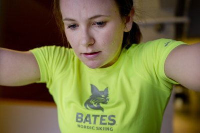 Nordic skier Sadie James '17 of Avon, Maine, prepares for the National Collegiate Men's and Women's Skiing Championships by working out on a SkiErg in Merrill Gym. (Phyllis Graber Jensen/Bates College)