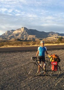 Katherine Creswell, who is on a California-to-Maine bicycle ride, pauses at Guadalupe Mountains National Park in Texas.