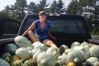 Katherine Creswell reaps the bounty that was the 2015 winter squash harvest.