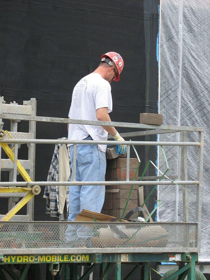 Work begins on the Commons' brick veneer on May 24, 2007. (Doug Hubley/Bates College)