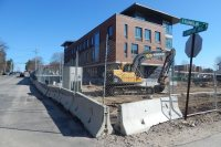 The construction fence was on its way out and Gendron & Gendron was doing site work at 65 Campus on April 15, 2016. (Doug Hubley/Bates College)