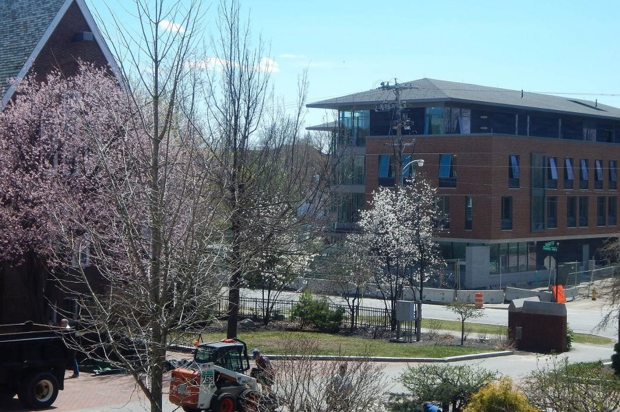 55 Campus Ave. seen through April blossoms from a second-floor window at Carnegie Science. (Doug Hubley/Bates College)