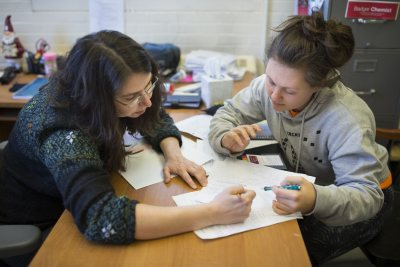 In her second floor Dana Chemistry office, biochemistry professor Paula Schlax helps AsiaLuna Patois '19 of Baltimore, Md. prepare for a chemistry exam.