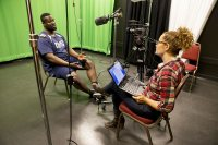 Tourse conducts a video interview with Adedire Fakorede '18 of Newark, N.J., in a studio at the Digital Media Studios. (Phyllis Graber Jensen/Bates College)