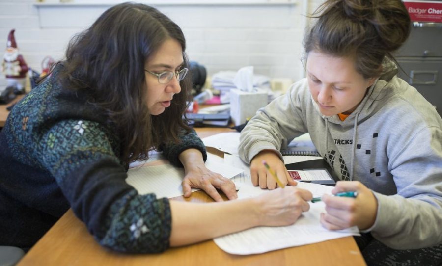 In mid-April, Professor of Chemistry Paula Schlax works with AsiaLuna Patlis '19 of Baltimore during finals week. Schlax is the 2016 recipient of the Kroepsch Award for Excellence in Teaching. (Phyllis Graber Jensen/Bates College)